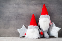 Christmas gnome und santa hat. Christmas pattern. Background on Royalty Free Stock Image