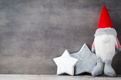 Christmas gnome und santa hat. Christmas pattern. Background on Royalty Free Stock Photos