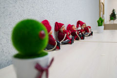 Christmas gnomes. Little fairy gnomes sit on a white background and hold on to a rope Stock Images