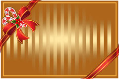Christmas gold background with bow and candy Stock Image