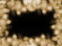 Christmas  gold background frame with bokeh lights Royalty Free Stock Photos