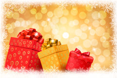 Christmas gold background with gift color boxes an Royalty Free Stock Images