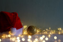 christmas gold ball decoration with garland warm lights Stock Image