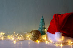 christmas gold ball decoration with garland warm lights Stock Images