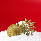 Christmas gold ball and snowball Stock Image