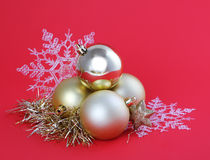 Christmas gold balls and snowflakes on red Stock Photo