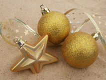 Christmas gold balls and star Royalty Free Stock Images
