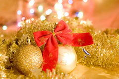 Christmas gold balls and tinsel for card Stock Photography