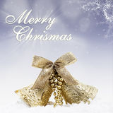 Christmas gold bell on blue lights background Royalty Free Stock Images