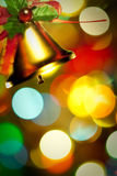 Christmas Gold bells with ribbon with colorful lig Stock Photo