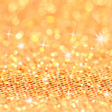 Christmas gold blinking background. Bokeh and Stars Stock Image