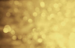 Christmas gold bokeh background. Luxury abstract holiday card. Royalty Free Stock Photography