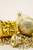 Christmas gold decoration, balls, beads, bell close up isolated Stock Photo