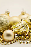 Christmas gold decoration, balls, beads, bell close up isolated Royalty Free Stock Photography