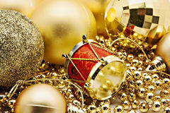 Christmas gold decoration, balls, beads, bell close up isolated Stock Images