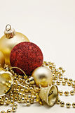 Christmas gold decoration, balls, beads, bell close up isolated Stock Photography
