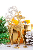 Christmas gold deer with branch firtree and gift Royalty Free Stock Images