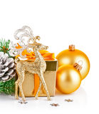 Christmas gold deer with branch firtree and gift Stock Photo