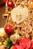 Christmas gold garland with full face mask. And red Christmas balls. Art decoration stock photography
