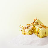 Christmas  gold gift boxes Royalty Free Stock Images