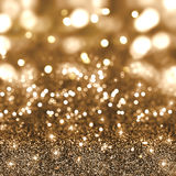 Christmas gold glitter background. Gold Christmas glitter background with stars and bokeh lights Stock Images