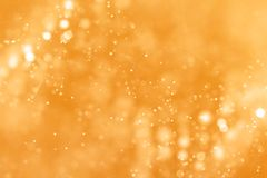 Christmas gold gradient sparkle glitter dust particles from top. On black background with bokeh flowing movement, golden holiday happy new year and valentine Royalty Free Stock Photos