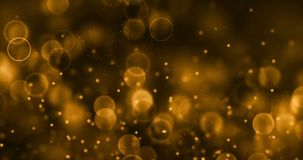 Christmas gold gradient sparkle glitter dust particles from top on black background with bokeh flowing movement, golden holiday stock footage