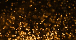 Christmas gold gradient sparkle glitter dust particles from top on black background with bokeh flowing movement, golden holiday stock video footage