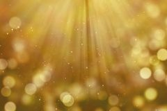 Christmas gold gradient sparkle glitter dust particles from top. On black background with bokeh flowing and ray light, golden holiday happy new year and Royalty Free Stock Photography
