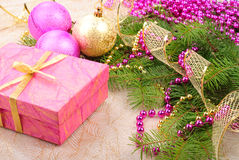 Christmas gold and pink with pine branch Stock Image