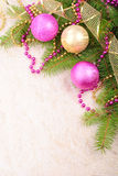 Christmas gold and pink with pine branch Stock Photography