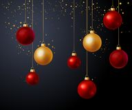 Christmas gold and red balls over black background. Christmas decoration with gold and red balls over black background. Vector illustration Stock Photo