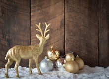 christmas gold silver ball and reindeer decoration with wood bac Royalty Free Stock Photos
