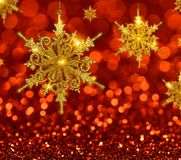 Christmas Gold Snowflakes on Red Background royalty free stock photos