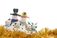 Christmas gold spangle with snowman family decoration isolated on white Stock Photos