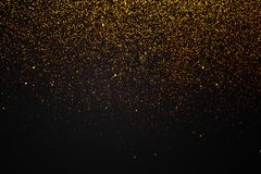 christmas gold sparkle glitter explosion dust particles background with bokeh, gold holiday happy new year and valentine day royalty free stock photo