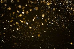 Christmas gold sparkle glitter explosion dust particles backgrou. Nd with bokeh, gold holiday happy new year and valentine day concept Stock Photography