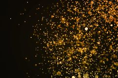 christmas gold sparkle glitter explosion dust particles background with bokeh, gold holiday happy new year and valentine day royalty free stock photography