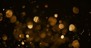 Christmas gold sparkle glitter explosion dust particles background with bokeh, flowing movement, gold holiday happy new year. And valentine day concept stock video footage