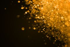 Christmas gold sparkle glitter explosion dust particles backgrou Royalty Free Stock Photo