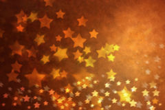 Christmas Gold Star Background. A rich golden background with glowing stars Stock Photo