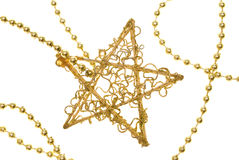 Christmas gold star on chain. Isolated on white royalty free stock photos