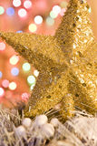 Christmas gold star on lights background Stock Photos
