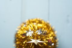 Christmas gold star on the tree top view, Stock Image