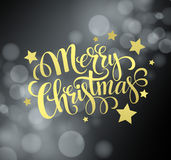 Christmas gold text  design on bokeh background Royalty Free Stock Image