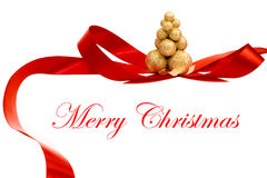 Christmas gold tree with red decoration Stock Images
