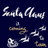 Christmas gold and white lettering design. Santa Claus is coming to town. Vector illustration Royalty Free Stock Image