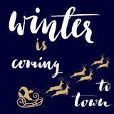 Christmas gold and white lettering design. Winter Stock Images