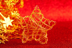 Christmas gold wire star on red glitter Stock Photography