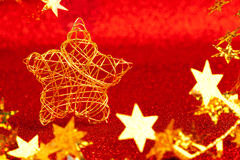 Christmas gold wire star on red glitter Royalty Free Stock Photography